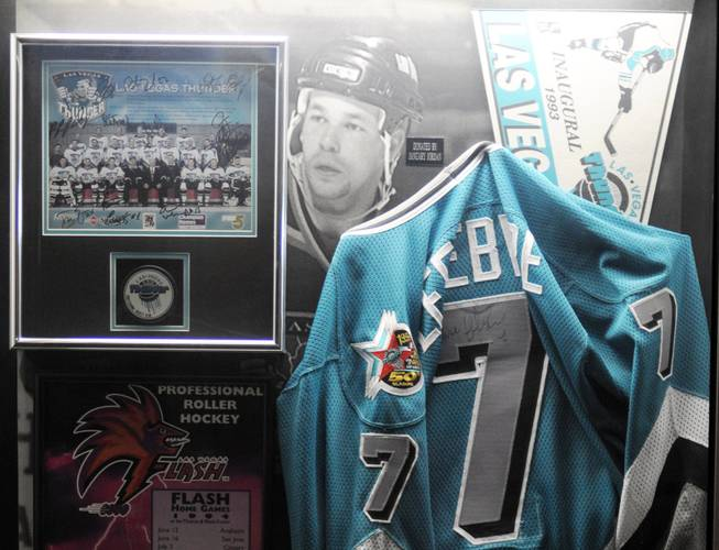 A display highlighting the various minor league hockey teams that have played inside the Thomas & Mack, hangs on a wall in the arena's concourse.