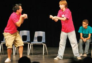 Centennial's Joshua Woofter, left, and Arbor View's Michael Swift practice their acting during the sixth annual Improv Festival on Oct. 16, at Centennial High School.