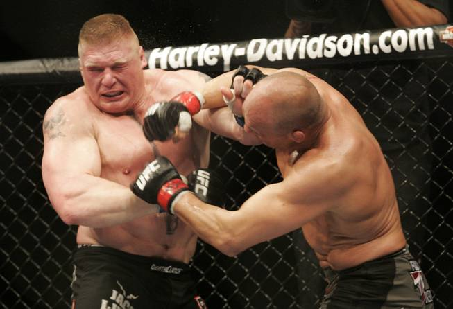 Heavyweight champion Randy Couture, right, and Brock Lesnar trade punches during their title fight Saturday, November 15, 2008 at the MGM Grand Garden Arena. Lesnar won by TKO in the second round.