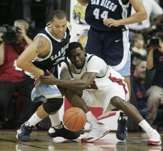 UNLV forward Darris Santee and San Diego forward Rob Jones fight for a loose ball during the first half of their game Saturday, Nov. 15, 2008.