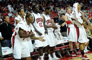 The Rebels' bench cheers on as UNLV pulls away from Texas-Pan American Tuesday night at the Thomas & Mack Center.