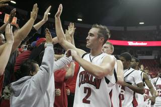 UNLV's Kendall Wallace thanks fans after beating Northern Arizona 87-71 on Thursday. Wallace finished with 14 points and UNLV improved to 3-0.