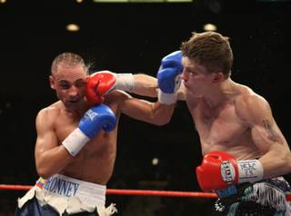 Ricky Hatton (right) of Britain connects with Paulie Malignaggi of the U.S. during a junior welterweight bout at the MGM Grand Garden Arena in Las Vegas. Hatton won by TKO in the 11th round.