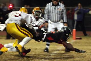 Las Vegas High School running back Raggie Bullock broke a 25-yard touchdown run with 27 seconds remaining in the game to finish off winning the Sunrise Regional title 35-28 against Del Sol at Frank Nails Field on Nov. 21.