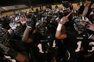 Palo Verde players celebrate their 50-14 Sunset Regional championship victory over Bishop Gorman in 2008.