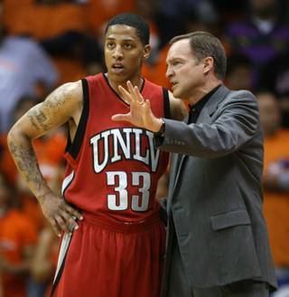 UNLV coach Lon Kruger instructs Tre'von Willis during the second half against UTEP on Monday in El Paso, Texas.