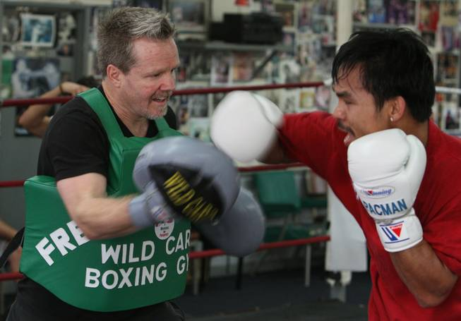 Roach, absorbing punches, says Pacquiao's speed will allow him to outmaneuver De La Hoya, a boxer Roach guided in a loss last year to Floyd Mayweather Jr.