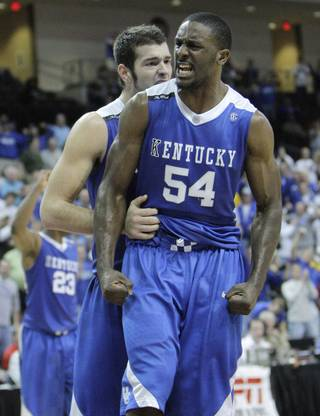 Kentucky's Patrick Patterson reacts after drawing a foul against West Virginia during the second half of the championship game of the Las Vegas Invitational. Patterson scored 15 points in Kentucky's 54-43 victory.