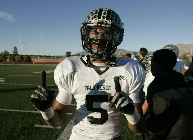 Palo Verde's Torin Harris signals the team's standing in the valley after defeating Las Vegas 42-21 Saturday.