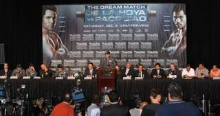 Boxer Oscar De La Hoya, center, speaks during a news conference at the MGM Grand on Wednesday, December 3, 2008. De La Hoya and Manny Pacquiao will meet in a 12-round welterweight fight at the MGM Grand Garden Arena on Saturday.