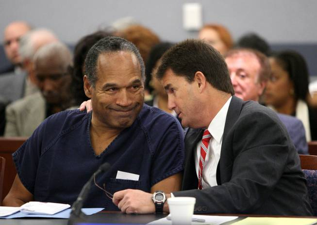 O.J. Simpson, left, listens to his attorney Yale Galanter during his sentencing hearing at the Clark County Regional Justice Center in Las Vegas Friday, Dec. 5, 2008.
