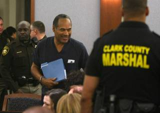 O.J. Simpson appears during a sentencing hearing at the Clark County Regional Justice Center in Las Vegas on Dec. 5, 2008.