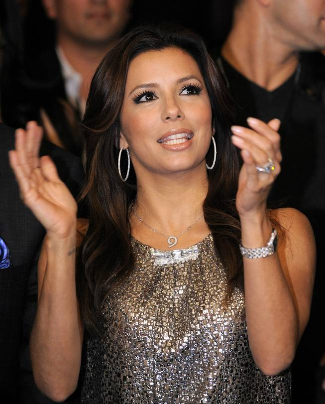Actress Eva Longoria Parker claps prior to Oscar De La Hoya's welterweight boxing match against WBC lightweight champion Manny Pacquiao.
