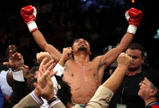 Manny Pacquiao celebrates his victory over Oscar De La Hoya after their welterweight