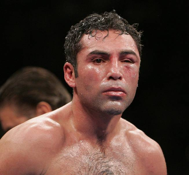 Oscar De La Hoya comes out of his corner for the eighth round during his welterweight fight against Manny Pacquiao at the MGM Grand Garden Arena. After losing the round and taking increasing punishment, De La Hoya's corner stopped the fight giving Pacquiao a TKO victory.