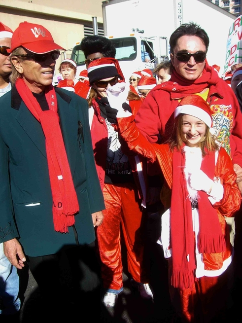 Siegfried & Roy with a young fan at the Great Santa Run Saturday, Dec. 6, 2008, in Las Vegas.
