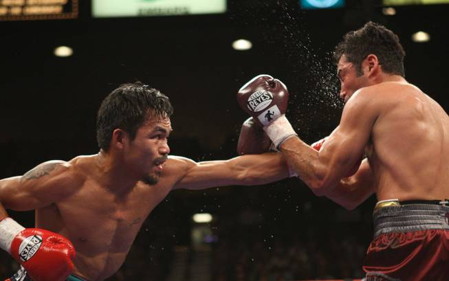Manny Pacquiao connects with Oscar De La Hoya their 'Dream Match' at the MGM Grand Garden Arena on Saturday night. Pacquiao won with an eighth-round TKO.