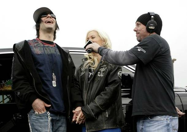 Criss Angel and Holly Madison were interviewed on KLUC 98.5 FM after they donated cash and dozens of toys to the station's annual toy drive.