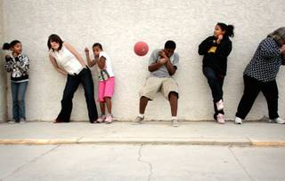 Kids and staff members play an outdoor game of dodgeball at Club Christ, an after-school program located inside the Buena Vista Springs apartment complex in North Las Vegas. From left are Paris Miller, 11, staff member Kendra Perry, Kierra Hlavacek, 10, Dezuan Fisher, 12,  Keanna Hlavacek, 12, and volunteer Linda Varela.