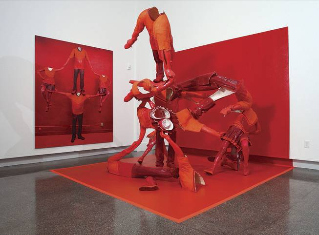 "The multimedia installation ""Cheerleaders,"" by Katie Grinnan, includes the wall-size depiction of headless, hollow-cast figures, which are taken apart and mounted using plastic, linoleum and various paints."