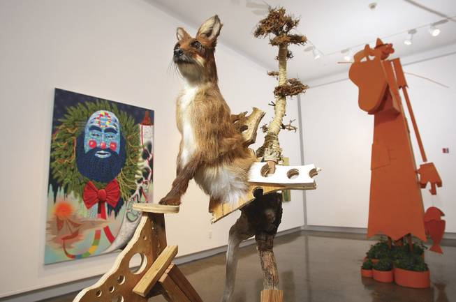 """S.O.S.,"" from left, is acrylic on canvas by Wendell Gladstone; ""Half Knot,"" by Jared Pankin, uses wood, sawdust, synthetic fur and glass eyes; and ""Country Boy"" by Wayne White is mixed media."