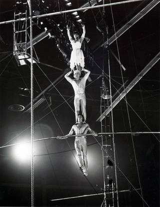 Fatima Gadjikovrbanova, top, balances atop her partner's shoulders during a daring act from her days with Ringling Bros. and Barnum & Bailey Circus. The photo was taken in the 90s before her husband's accident and before she moved to Las Vegas.