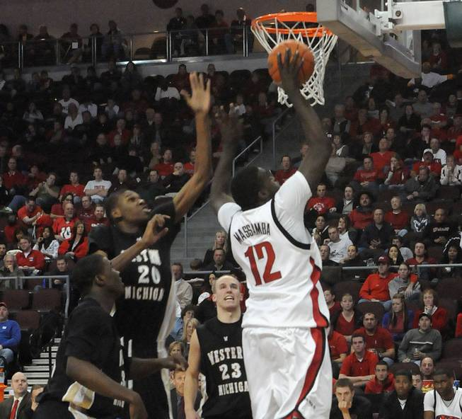 Brice Massamba of UNLV lays it in for two at the Orleans Arena where UNLV took on Western Michigan Sunday afternoon.  UNLV beat Western Michigan 70-61.