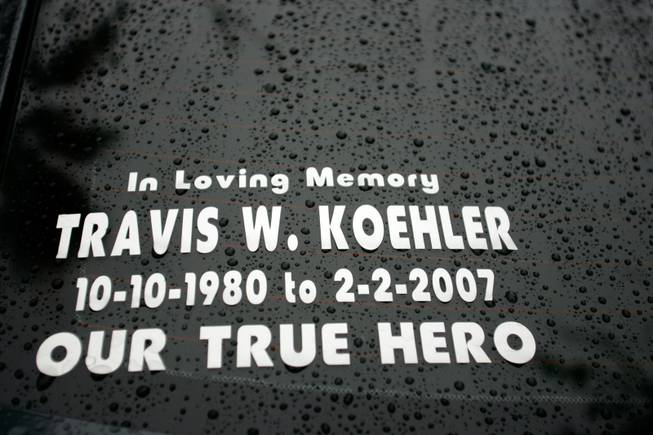 On the rear window of Debra Koehler-Fergen's car is a memorial to her son, Travis Koehler.