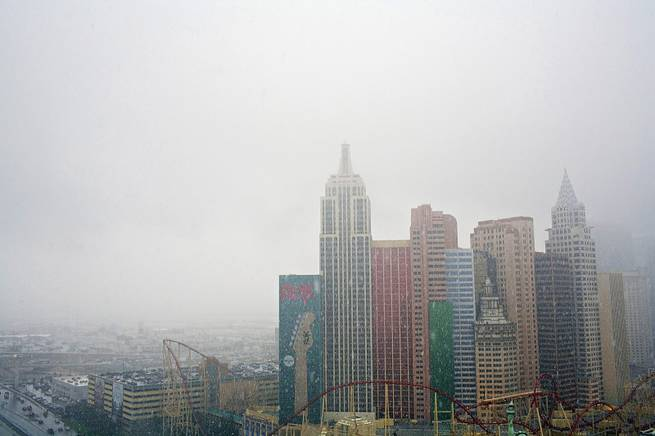 Snow comes down on the Las Vegas' New York New York, as seen from the roof of the Tropicana Hotel and Casino on Wednesday, Dec. 17, 2008.