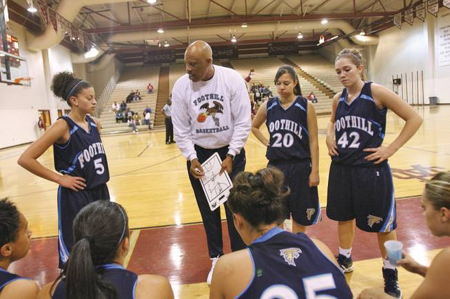 Foothill's girls basketball coach Keith Starr talks to his team during a time out during a game at Cimarron-Memorial.