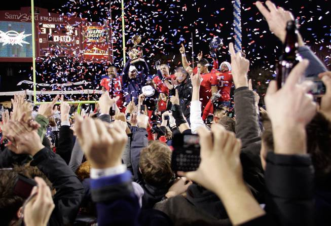 Arizona celebrates a win over BYU in the Pioneer Las Vegas Bowl at Sam Boyd Stadium on Saturday. Arizona won the game 31-21.