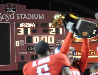 Arizona celebrates a win over BYU during the Pioneer Las Vegas Bowl at Sam Boyd Stadium Saturday. Arizona won the game 31-21.