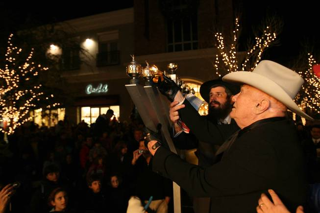 Actor Tony Curtis, right, and Rabbi Mendy Harlig of Chabad of Green Valley take part in a ceremonial menorah lighting Tuesday, Dec. 23, 2008, at The District at Green Valley Ranch in Henderson. The event was presented by Chabad of Green Valley, Congregation Ner Tamid and Midbar Kodesh Temple.