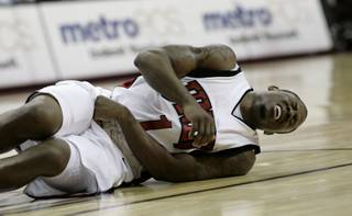 Wink Adams falls to the floor in pain with an abdominal injury Dec. 23 at the Thomas & Mack, where UNLV took on Southern Utah.  UNLV defeated SUU 73-60.