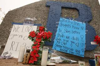 A makeshift memorial for Basic High school choir teacher Matthew Thomas Cox is seen outside Basic High.