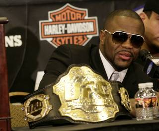Rashad Evans poses with his new UFC light heavyweight title belt after a third-round TKO over Forrest Griffin Saturday night at the MGM.