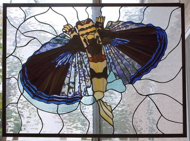 """Flying Gurnard,"" a stained glass piece by Christine Curtis Wilson, will be exhibited at the Summerlin Library."