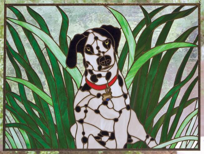 """Orbit,"" a stained glass piece by Christine Curtis Wilson based on her dog, will be exhibited at the Summerlin Library."
