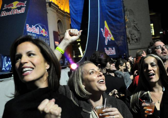 Fans cheer after Robbie Maddison jumps off the Arch De Triumph at the Paris Las Vegas on New Year's Eve.