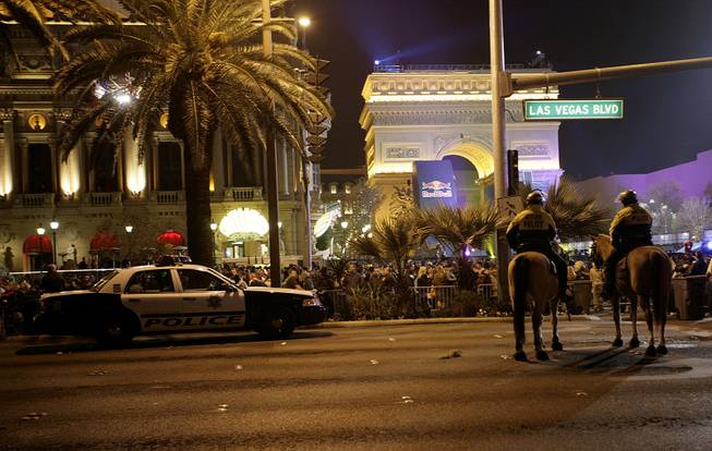 Police patrol the Strip near the Paris Las Vegas on New Year's Eve.