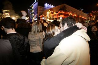 A couple brings the new year in with a kiss on the Las Vegas Strip.