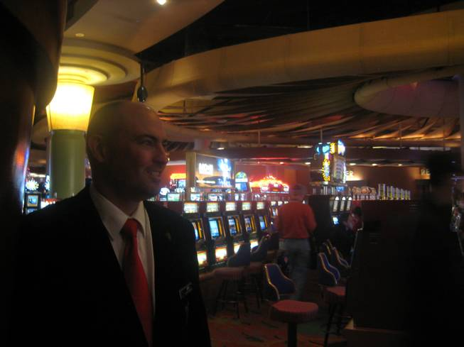 <p>7:45 p.m.: Playboy Club floor supervisor Jeff Dwyer enjoys the relative calm of the Palms casino floor before heading up to the mayhem of his work environment.</p>