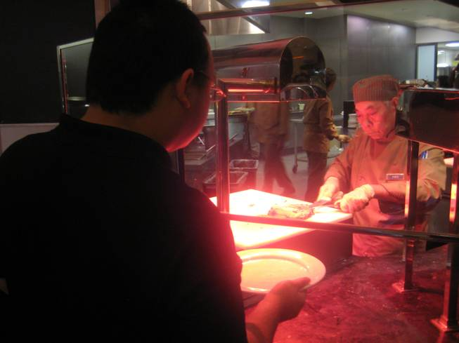 <p>8 p.m.: People lined up on Dec. 31 to get their fill of New Year's Eve eats at the Palms' Bistro Buffet.</p>