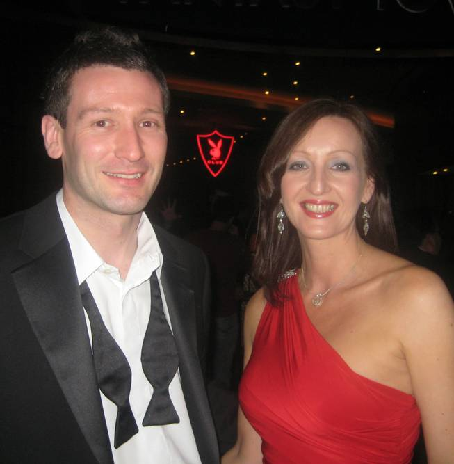 <p>9:30 p.m.: Andrew Moss, left and Tracey Martin, right, flew to Las Vegas from West Yorkshire, England, to celebrate New Year's Eve at the Playboy Club. They lined up early to ensure they made the most of the party.</p>