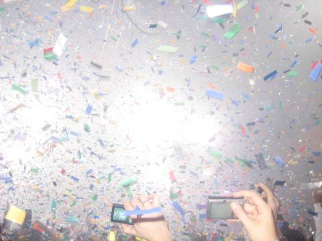 Midnight: Confetti drops, music blares and people dance and celebrate as they ring in 2009 at Rain.
