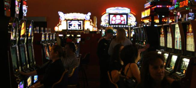 8:25 p.m.: Gamblers at the Palms try their luck with the one-armed bandits and try to hit the jackpot before the new year arrives.