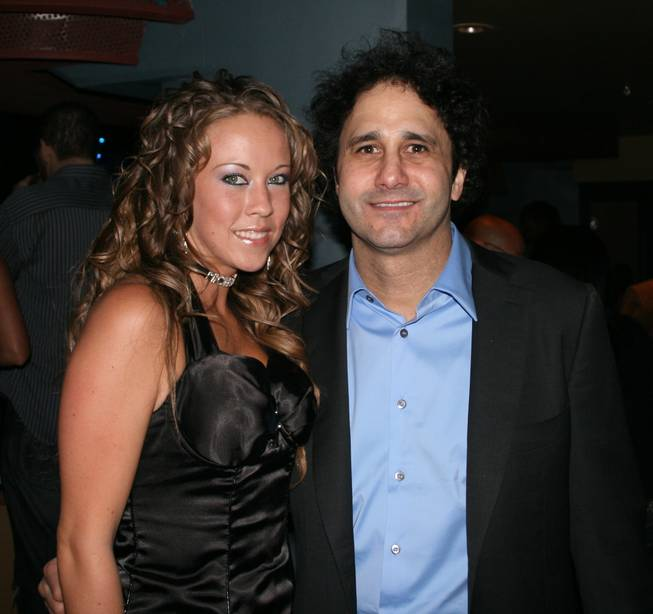 Cocktail server Michelle Garlick and Palms owner George Maloof smile for the camera while taking in the sights and sounds of the Kid Rock concert from Maloof's private box at the Pearl on New Year's Eve 2008.