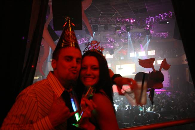 "<p>11:55 p.m.: Kale Durocher, left, and Cassi Carington, right, came to Las Vegas from sun-drenched Hawaii to celebrate New Year's Eve together at Rain. Both said they are ""huge"" fans of Perfecto DJ Paul Oakenfold.</p>