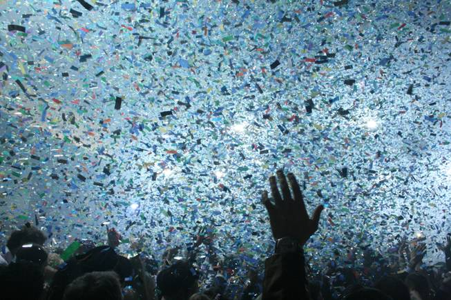 Midnight: Rain rings in 2009 with a cloud of colorful confetti and the sounds of Perfecto DJ Paul Oakenfold.