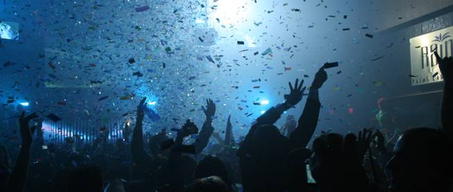 Midnight: As the cloud of confetti clears the New Year's Eve party continues at Rain.